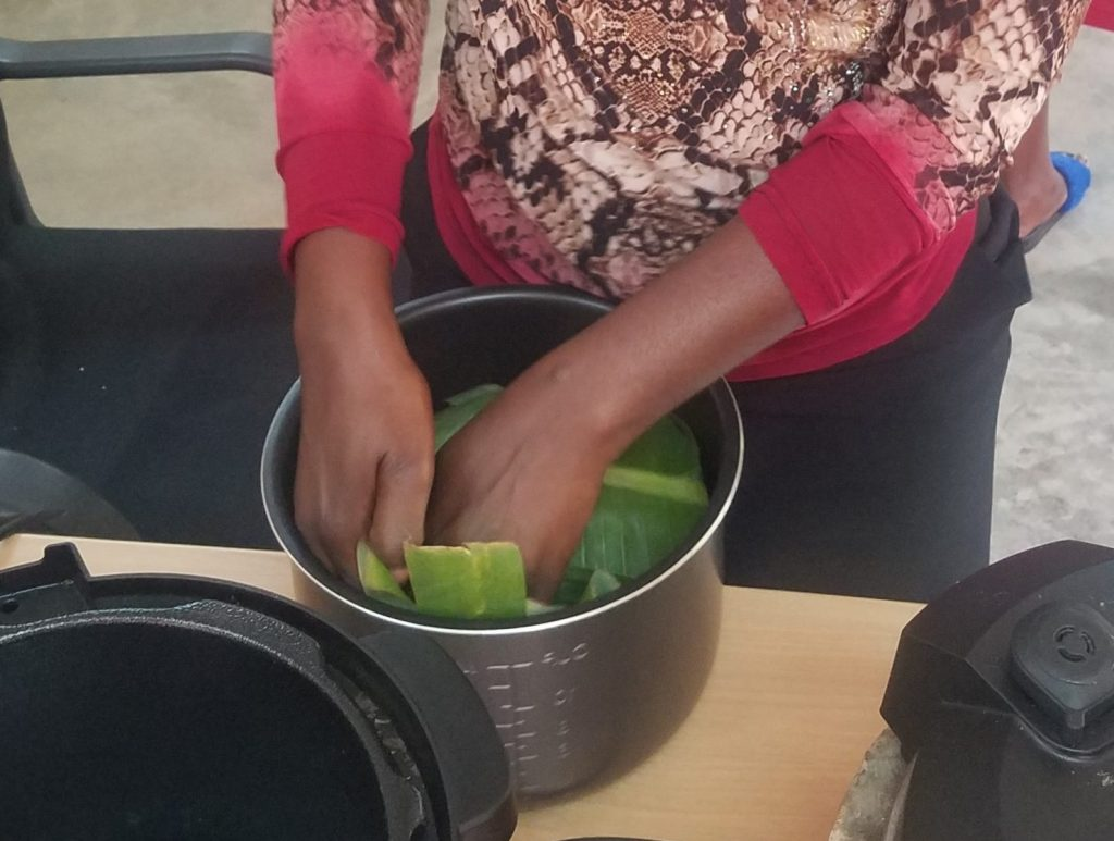 Controlled cooking test being conducted in Uganda